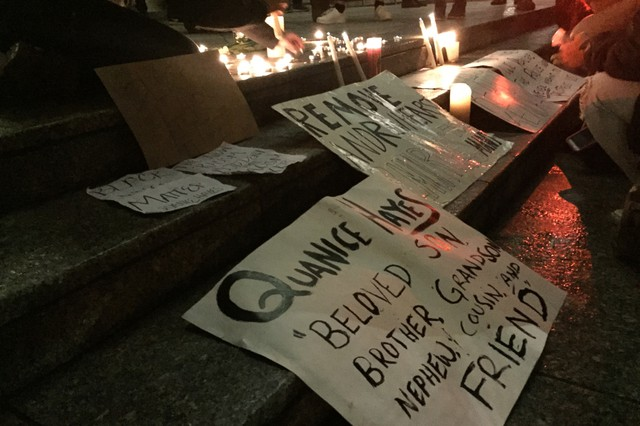 Demonstrators placed signs and candles on the steps of the Multnomah County Justice Center in downtown Portland, Feb. 16.