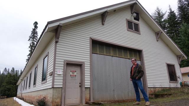 Teacher Chris Mathas stands by the shuttered Butte Falls hatchery in rural southern Oregon.