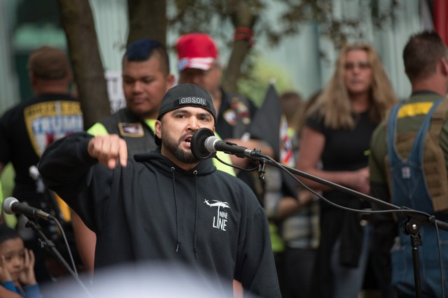 A 2017 file photo of Patriot Prayer leader Joey Gibson addressing a crowd at a rally and holding a moment of silence for the victims of the Portland MAX train stabbings.