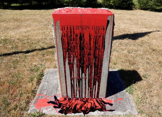 Two stone markers honoring Jefferson Davis in Clark County were discovered covered in black and red paint Friday morning.