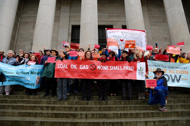 Opponents of a proposed oil terminal in Vancouver, Washington, gather on the steps of the Capitol building in Olympia.