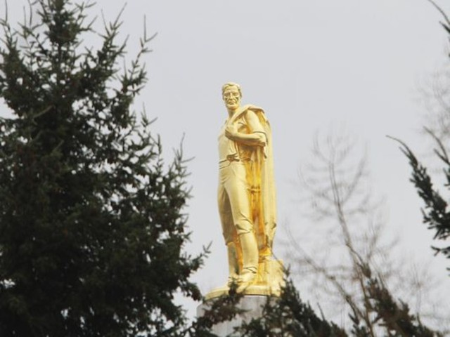 """The Oregon Pioneer, or """"Gold Man,"""" stands atop the Oregon Capitol in Salem."""