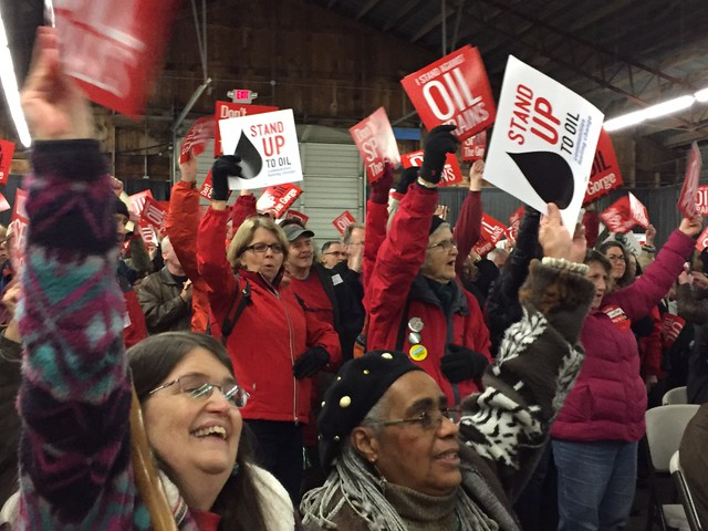 Opponents of the proposed Vancouver Energy terminal dressed in red and held a rally during a break in the hearing Tuesday.