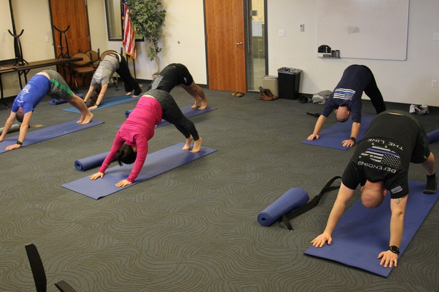 Officers typically carry 30 pounds of gear on their bodies including vests, boots and weapons. Yoga helps keep these officers flexible and can help prevent injuries.