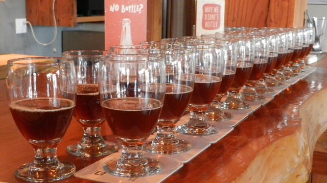 A taste test: Migration Brewing presented samples of its low-carbon red beer (on coasters) alongside its traditional red beer.