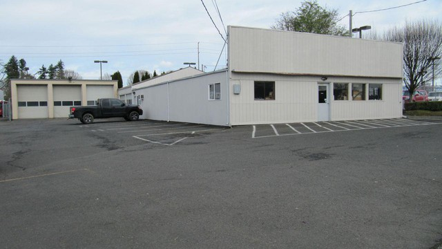 The city of Beaverton's downtown revitalization plans depend in large part on redeveloping sites like this old Amoco station, where underground fuel tanks and hydraulic car lifts have contaminated the underlying soil.