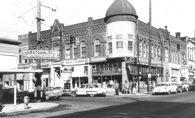 In the heart of the Albina district, the corner of North Williams and North Russell was once the center of a small yet thriving business district. These businesses were torn down in the early 1970s as part of large-scale urban renewal projects. Photo ca 1962.