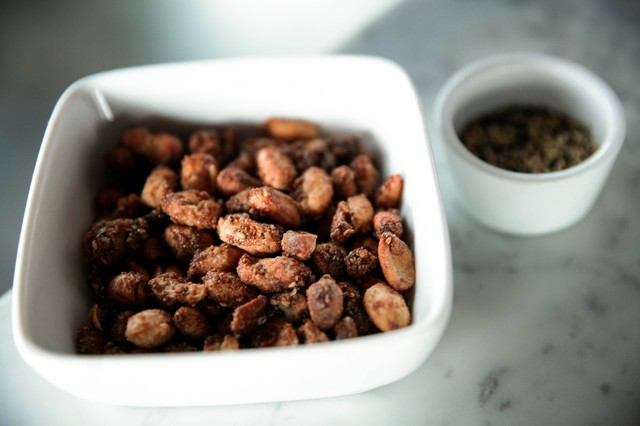 Furikake rice seasoning, right, is an essential flavoring in Spicy Candied Peanuts. Try making this sweet, sandy-textured snack using other raw nuts such as pecans, walnuts or blanched almonds.