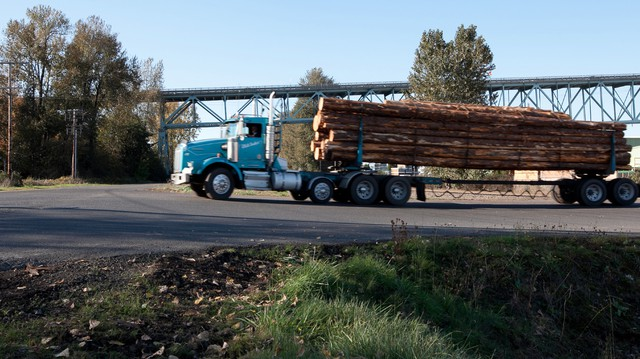 A log truck rolls by in Columbia County.