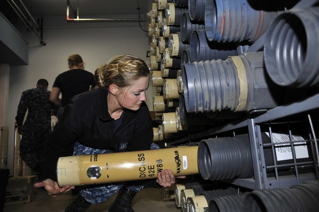 Sailor Renee Duhaime places a sonobuoy onto a storeroom rack. The Navy wants to deploy 700 of these sub-hunting devices in the waters of the Pacific off the coastline of Washington and Oregon.