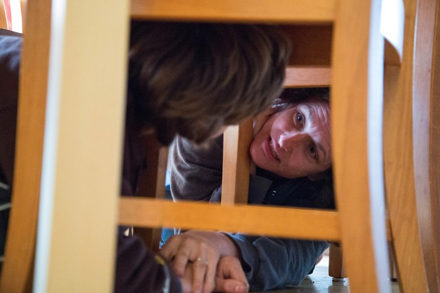 The Stephens family practices earthquake drills at their home in North Portland. Experts say during an earthquake you should drop, cover, and hold on until the shaking stops.