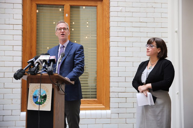 Portland Mayor Ted Wheeler and Commissioner Chloe Eudaly at a press conference unveiling a phone app meant to streamline the house hunting process for renters in Portland.