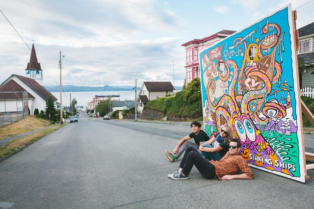Hey Lover in Astoria, Oregon with the finished piece of artwork.