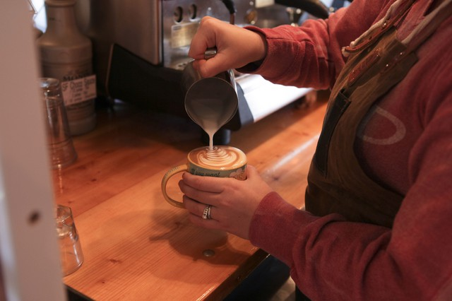 Jordan Heinz pours a latte at the Jolts and Juice Coffee Company.