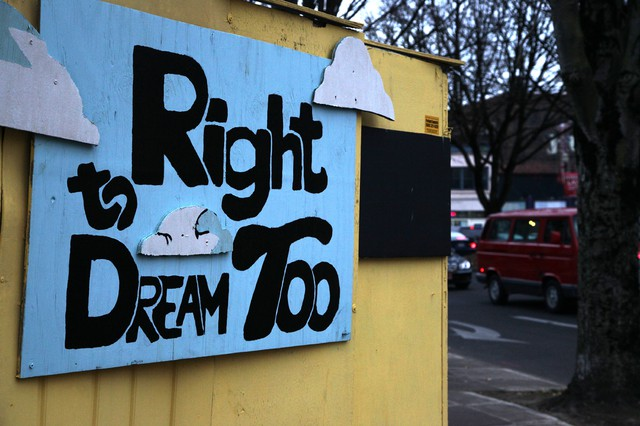 A sign welcomes visitors to the Right 2 Dream, Too homeless camp in downtown Portland.