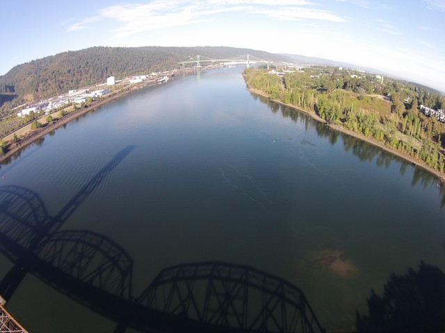 The shadow of the Railroad bridge reflected on the surface of the Willamette River in the Portland Harbor Superfund site.