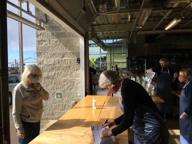 Local Ocean Seafoods owner Laura Anderson greets customers at her empty restaurant, which is now offering seafood meal kits for pick-up and delivery.