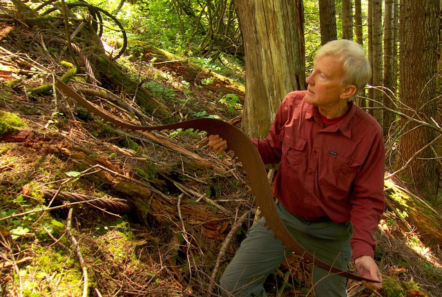 Don Nelsen finds an old saw blade. He does not keep souvenirs, considering all his finds historic relics which should remain where they fell.