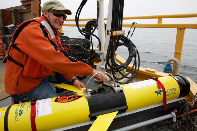 OSU oceanographer Jack Barth prepares a glider that will spend weeks flying through the ocean, collecting data on ocean acidification and oxygen levels.