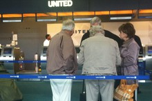 Travelers at PDX.