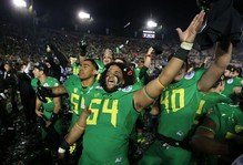 Oregon's Hamani Stevens, center, celebrates with the rest of the Duck Football team after winning the Rose Bowl 59-20 in Pasadena, Calif.