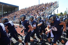 The George Fox Bruins charge the field for their first game in 46 years.