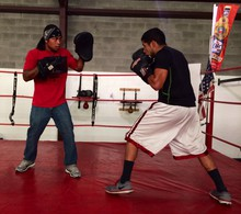 Spartan Boxing Gym owner Troy Wohosky trains Hector, one of the members of the club in Medford.