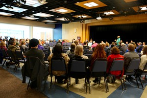 Several people gathered in an auditorium at Clark College in Vancouver to discuss recent hate incidents on campus.