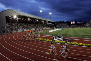 Runners cruise by the east grandstand of historic Hayward Field in Eugene. Stakeholders worry about a lack of transparency as the project undergoes renovations for the 2021 world track championships.