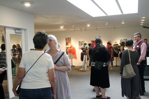 Attendees peruse the final exhibition at Oregon College of Art and Craft's Hoffman Gallery on Saturday, May 18, 2019.