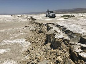 USGS scientists examine a surface rupture created during the M7.1 Searles Valley earthquake in 2019.