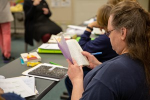 "A student in PSU's new ""Metamorphosis"" class at Coffee Creek Correctional Facility looks through a journal back in October. The 15-credit general education course was offered for the first time this year -- because of COVID-19, the class is ending differently than it started."