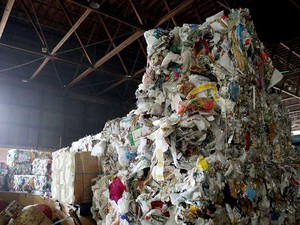 Trash that cannot be recycled or sold is baled to be sent to a landfill at Garden Recycling in Sale on Friday, Aug. 3, 2018.