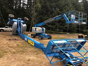 A boom lift tipped over at the scene of the Pickathon music festival Thursday, Aug. 8, 2019, killing the two workers who were working on it while dismantling the main even stage in Happy Valley, Ore.