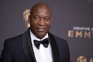 John Singleton arrives at night one of the Creative Arts Emmy Awards at the Microsoft Theater on Saturday, Sept. 9, 2017, in Los Angeles.