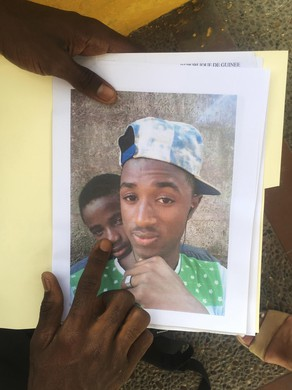 Mamadou Aliou Barry carries this picture of him and a friend together and another picture of his friend after he was murdered, for his asylum interview.
