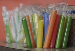 This July 17, 2018 photo shows wrapped plastic straws at a bubble tea cafe in San Francisco.