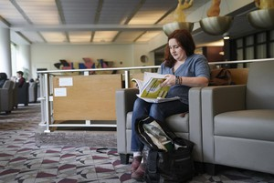 Jade Souza, 36, looks through her textbook in a study lounge at Portland State University, Tuesday, April 24, 2019.