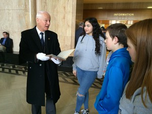 Oregon Secretary of State Dennis Richardson shows off the original state constitution to visitors at the Oregon Capitol.
