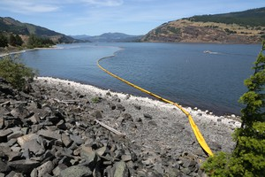 Emergency crews on June 4, 2016, found an oil sheen on the bank of the Columbia River near the site of an oil train derailment and spill in Mosier, Oregon, the day prior.