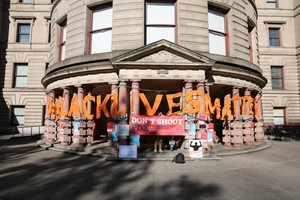 Activists with Don't Shoot PDX protested outside City Hall over a proposed labor agreement with the Portland Police.