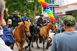 Portland police officers patrol during the 2014 Portland Pride Parade.