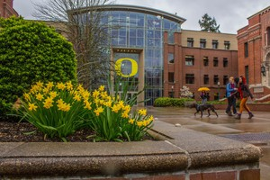 Students walk across the University of Oregon campus on a rainy March day in this 2015 file photo.