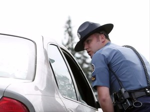 Oregon State Police Senior Trooper Cameron Bailey pulls over a driver for speeding while patrolling for distracted drivers along a section of Interstate 5 in an unmarked patrol vehicle on Tuesday, April 5, 2016, during a ride along.