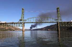 Smoke from an oil train fire is seen beyond the Hood River Bridge in the Columbia River Gorge on Friday, June 3, 2016.