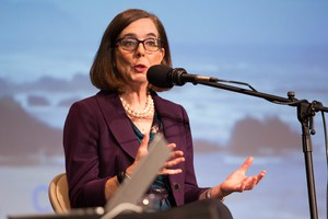 Oregon Gov. Kate Brown responds to a question at a gubernatorial debate at Winston Churchill High School in Eugene on Oct. 6, 2016.