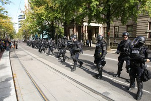 Police in riot gear respond to a protest outside Portland City Hall.