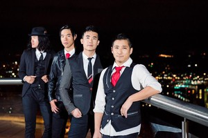 Members of The Slants pose for a photo. From left to right, guitarist Joe X. Xiang, vocalist Ken Shima, bass and bandleader Simon Tam, and drummer Yuya Matsuda.