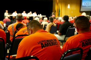 Supporters of the oil terminal project included local labor unions, who wore orange T-shirts at the hearing. Opponents of the project dressed in red.
