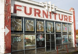 As part of the effort to remake the neighborhoods along 82nd Avenue, community groups plan to turn this old furniture store into a community center and affordable housing.